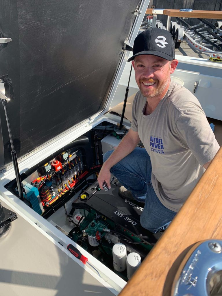 Photo of technician servicing a Volvo Penta diesel engine.